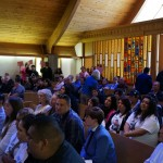 An overflow crowd came together for the Peace, Power and Youth symposium.