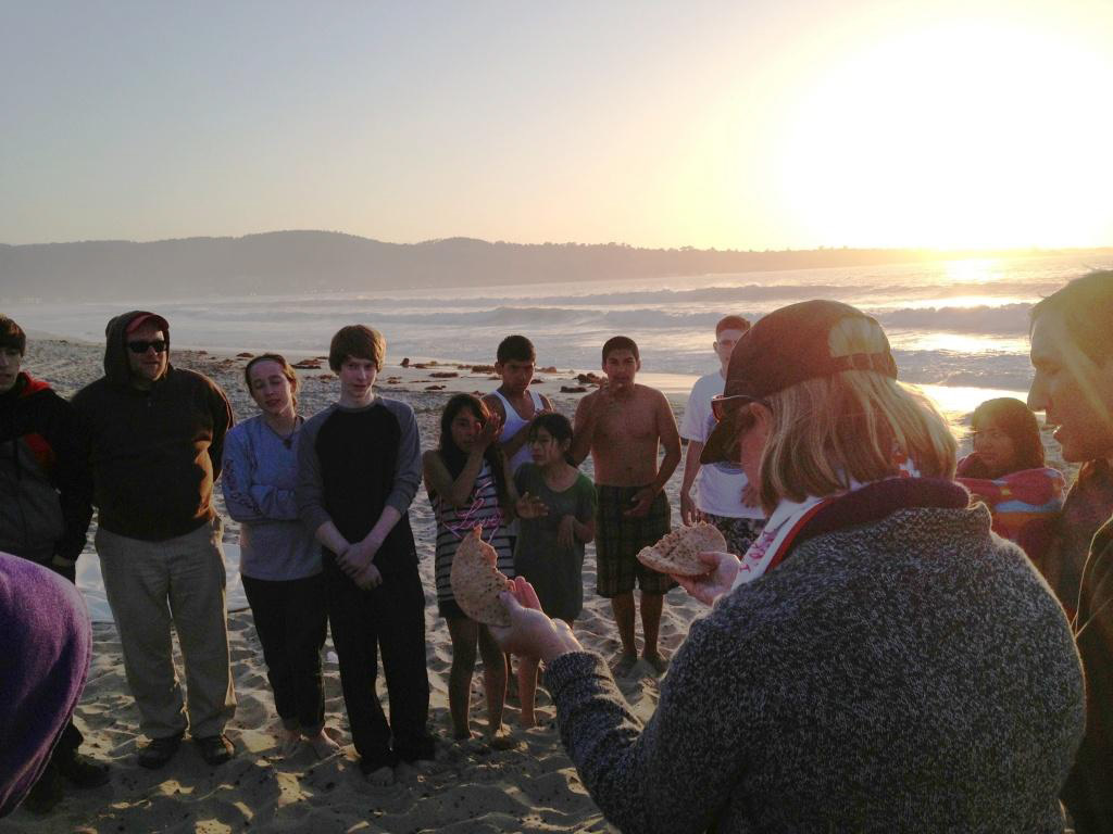 Youth from Macon, Seaside, and Watsonville at Eucharist on the beach in Monterey with Bishop Mary.