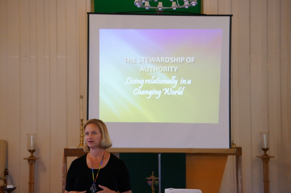 Bishop Mary gives a presentation on community organizing.